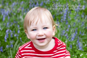 West London child photographed in the Chilterns, Buckinghamshire for an outdoors on-location family portrait photography shoot amongst bluebells in the woods