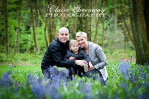 West London family photographed in the Chilterns, Buckinghamshire for an outdoors on-location family portrait photography shoot amongst bluebells in the woods