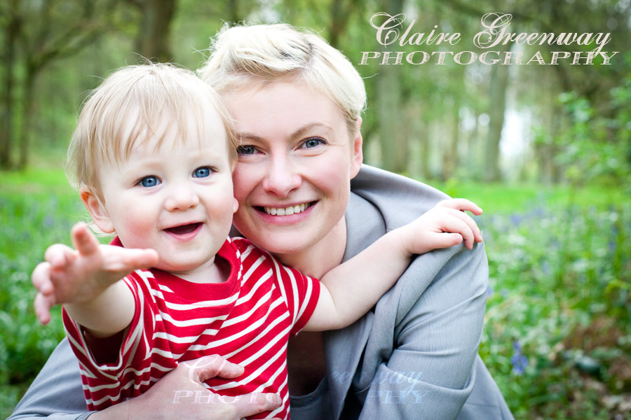 West London smiling mother and child photographed in the Chilterns, Buckinghamshire for an outdoors on-location family portrait photography shoot amongst bluebells in the woods