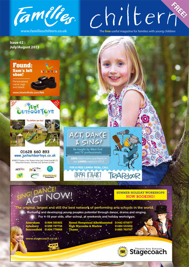 Chiltern Families Magazine cover photograph featuring a child siting in a tree smiling for a portrait on a Buckinghamshire family photography shoot outdoors in the Bucks woods during the summer. The child wears a floral top and has climbed a tree.